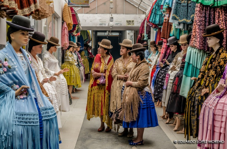 Cloned in a dress shop, the 'cholitas' wrestlers look for a new outfit.
